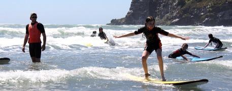 Children surfing at Sumner Beach
